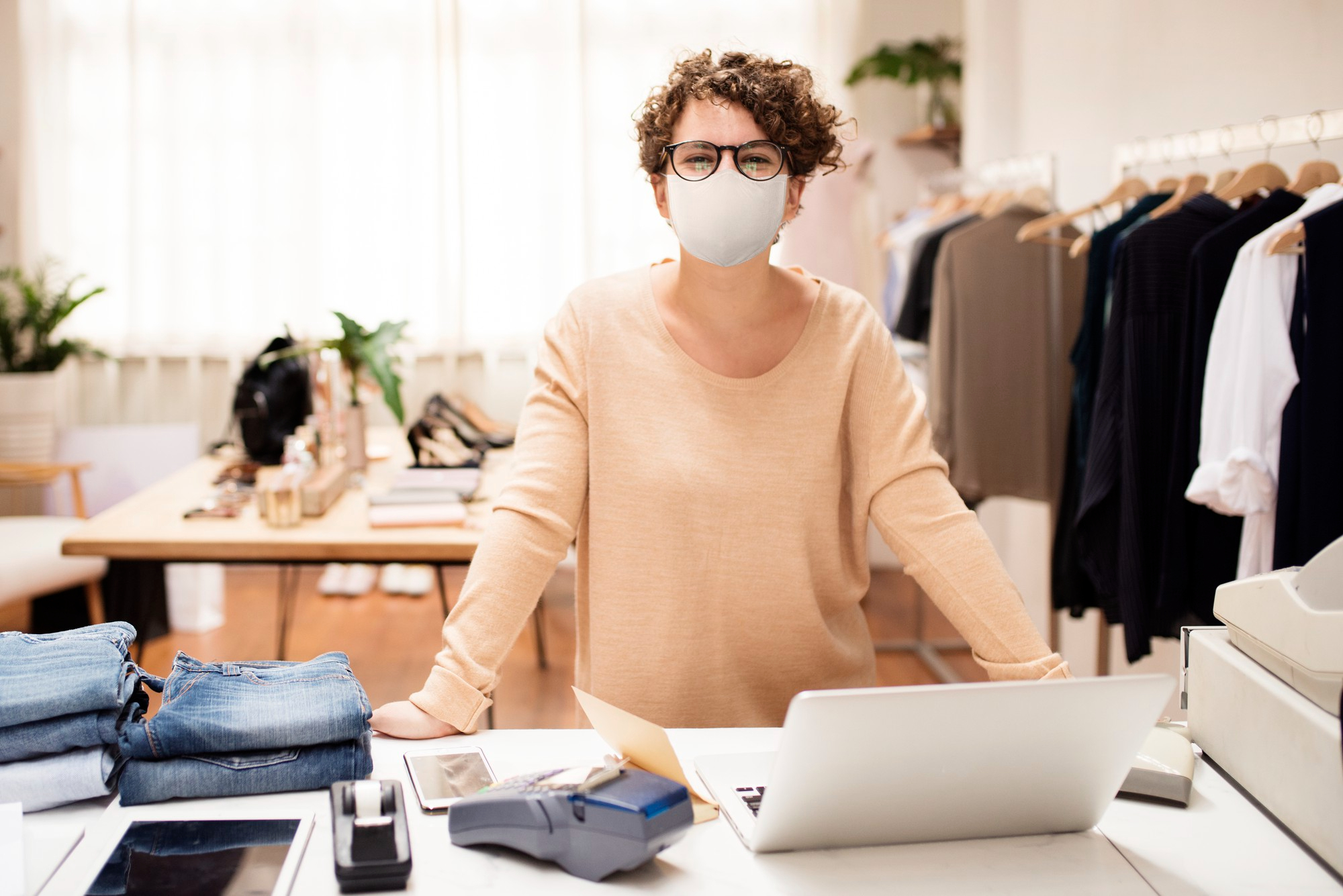 retail shop owner in mask social distancing shopping